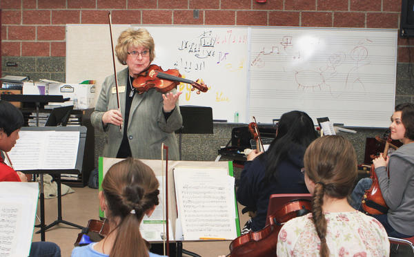 Budding musicians from across the state attend  a Day for Music seminar at the Charlevoix High School, sponsored by the Great Lakes Chamber Orchestra. The fourth annual event features the expertise of music director Carlos Botero of South America, orchestra director Valerie Palmieri of Adrian College, a dozen volunteers from the Great Lakes Chamber Orchestra and others from the school to help students progress from introduction to public performance in a single day-long seminar.