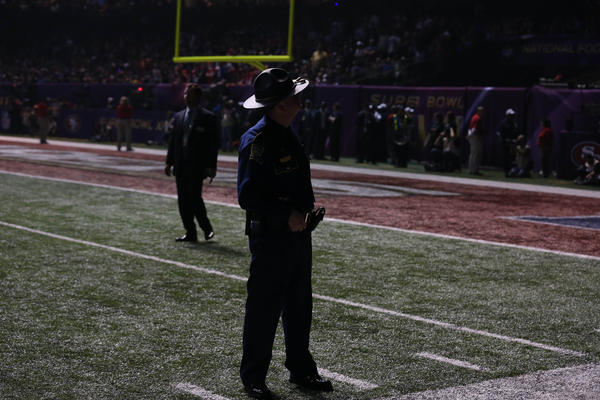 A policeman guards the field during the third quarter blackout in Super Bowl XLVII between the San Francisco 49ers and the Baltimore Ravens at the Mercedes-Benz Superdome.