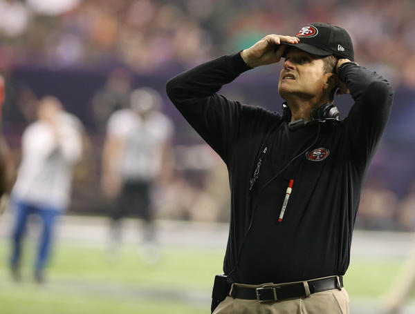 San Francisco 49ers head coach Jim Harbaugh reacts to a blackout in the third quarter against the Baltimore Ravens in Super Bowl XLVII at the Mercedes-Benz Superdome.