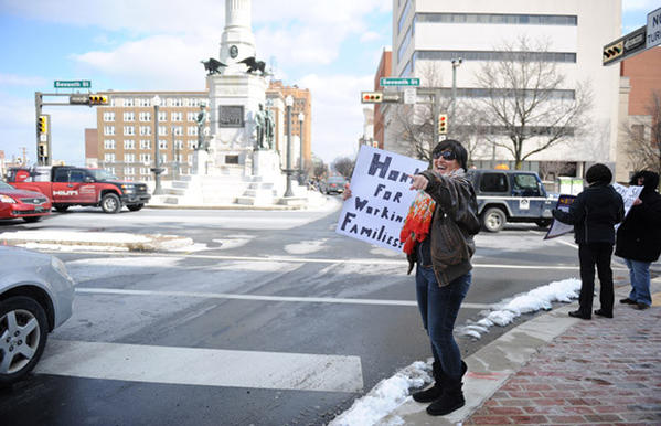Bar Johnston, of Center Valley, protests Governor Corbett¿s corporate tax giveaways and loopholes, which have cost Pennsylvania $1 billion each year he has been in office. A group holds a protest outside Senator Pat Browne¿s office on Monday.