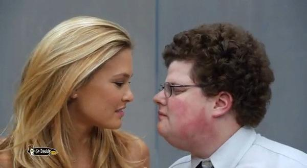 "GoDaddy's ""Perfect Match"" Super Bowl commercial featured a kiss between model Bar Refaeli and a man portraying an archetypal tech nerd."