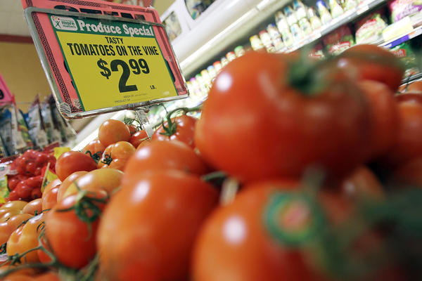 The U.S. and Mexico averted a tomato trade war after the Commerce Department released a draft of a new trade agreement Saturday governing the prices of imported tomatoes. Above, tomatoes are sold in a New York City grocery store.
