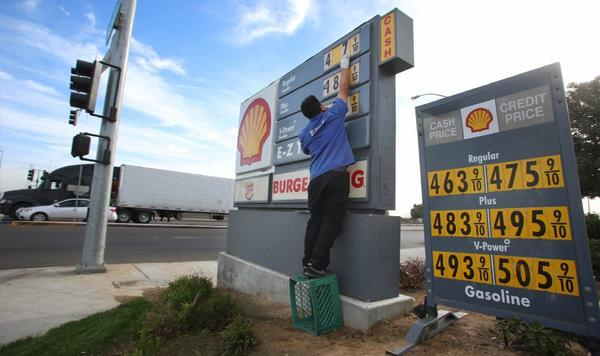 In this Oct. 5, 2012, photo, Luis Cuevas changes the gas prices at the Shell station off California State Route 99. Stunning numbers like these have more Americans shopping for bargains and joining brand loyalty programs to get a break on gasoline prices.