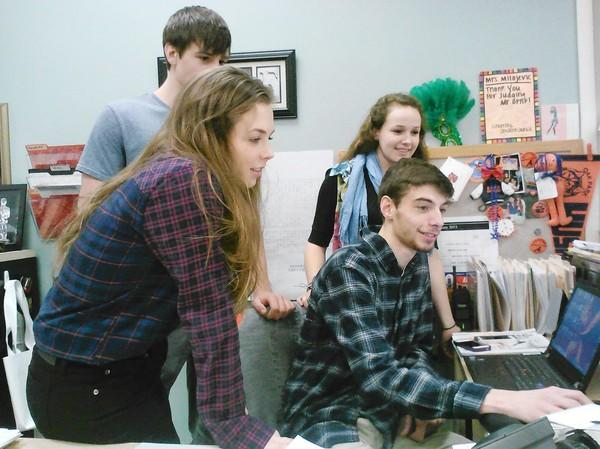 OPRF seniors Zoe Bergstrom, front, Adam Bujnowski, left, Maggie Blaha and Steven Piper have all used the school's compliments page on Facebook.
