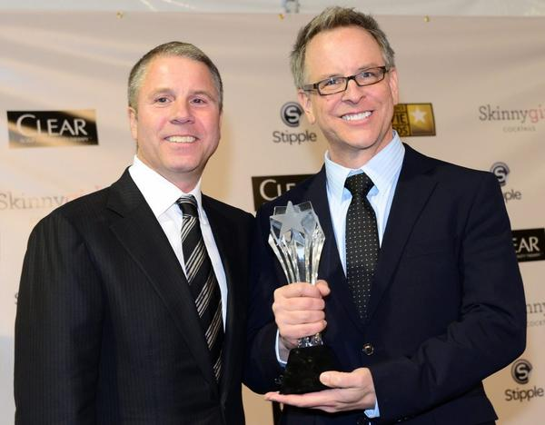 """Wreck-It Ralph"" director Rich Moore, right, and producer Clark Spencer celebrate at the Critics Choice awards, one of several prizes they've picked up during the awards season. Will Oscar be next?"