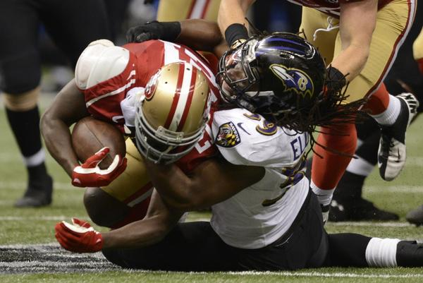 Dannell Ellerbe (R) of the Baltimore Ravens brings down Frank Gore (L) of the San Francisco 49ers during Super Bowl XLVII at the Mercedes-Benz Superdome on February 3, 2013 in New Orleans, Louisiana.