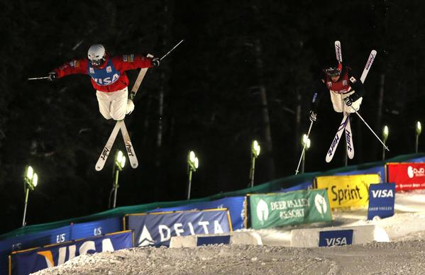 Third place finisher Bradley Wilson of the U.S. (L) and first place finisher Alex Bilodeau of Canada, compete during the men's dual mogul final at the FIS World Cup Freestyle skiing competition in Park City, Utah, February 2, 2013.