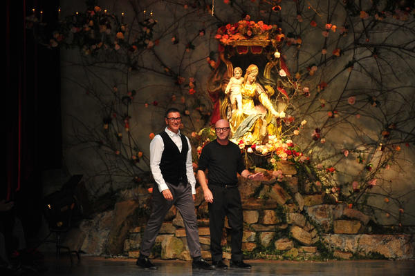 Italian designers Stefano Gabbana (L) and Domenico Dolce acknowledge the audience at the end of the Dolce & Gabbana Fall-Winter 2013-2014 Menswear collection on January 12, 2013 during the Men's fashion week in Milan.