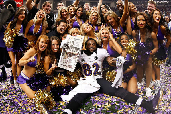 Torrey Smith #82 of the Baltimore Ravens celebrates with the Ravens cheerleaders following their win against the San Francisco 49ers during Super Bowl XLVII at the Mercedes-Benz Superdome on February 3, 2013 in New Orleans, Louisiana.The Ravens defeated the 49ers 34-31.