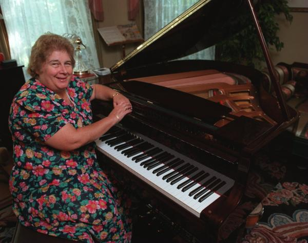 Linny Fowler (cq) sits at a piano in her Bethlehem home where members of the Preservation Hall Jazz Band will play at a reception before their performance at the Zoellner Arts Center October 21. Photo taken 9/30/97