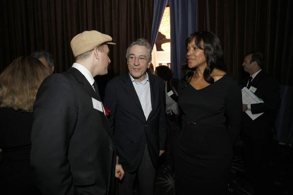 """Silver Linings Playbook"" supporting actor nominee Robert De Niro, center, and his wife Grace Hightower speaking with J. Ralph, left, nominated for his original song, ""Before My Time,"" in the documentary ""Chasing Ice."""
