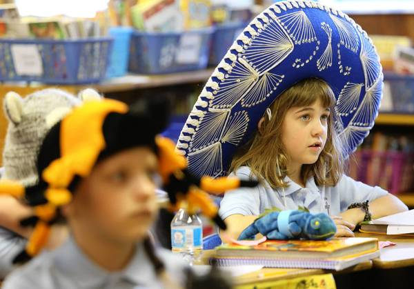 Third grader Ashley Miller, wears a giant sombrero to class. Students at Faith Lutheran School wore a variety of hats on Crazy Hat Day, part of a weeklong series of activities to mark National Lutheran Schools Week, Jan. 27 - Feb. 2.