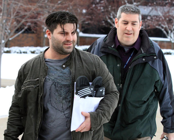 Former Schaumburg police officer Matthew Hudak, left, leaves the DuPage County jail after posting a $35,000 bond on Feb. 4. He and two other former Schaumburg police officers are accused of stealing and selling drugs.