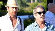 Mel Gibson and Gerard Butler were seen dining at Zuma in Miami last week with a large group of (uh, mostly ladies) friends.