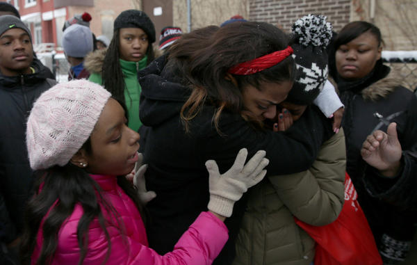 Lindblom Math and Science Academy's Darnisha Stevenson, 17, second from left, Jordyn Willis, 17, comfort Chelsea James, 17, who is overcome with emotion as they join about 30 students and adult leaders at Dr. Martin Luther King College Prep High School for a press conference and march against gun violence.