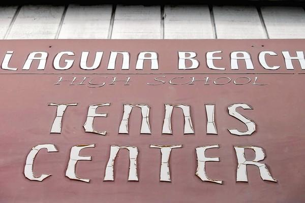 A closer look at the Laguna Beach High School Tennis Center sign reveals weathered lettering.