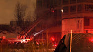 One firefighter was injured at an extra-alarm blaze in an abandoned factory in the Back of the Yards neighborhood that was being brought under control this evening.