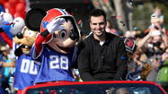 I hope UCF student Jon Keller got a nice close-up photo of Joe Flacco at the Disney parade Monday. Flacco showed off a rare smile and waved to the hundreds of Baltimore Ravens fans dressed in purple jerseys who eagerly waited for his hour-late Super Bowl MVP hero's welcome at Magic Kingdom.