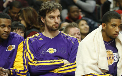 Los Angeles Lakers forward Pau Gasol sits on the bench during the first half of a game against the Chicago Bulls.