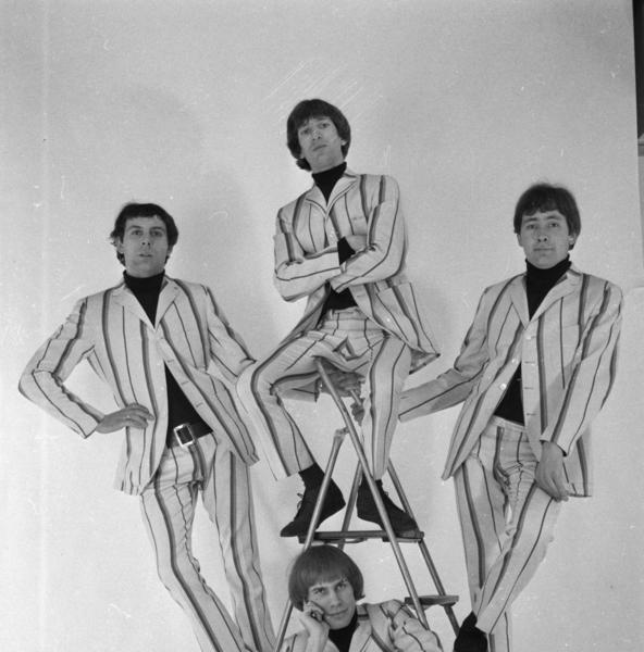 Reg Presley (right) of 60s rock band The Troggs in 1966 with bandmates Chris Britton, Peter Staples and Ronnie Bond wearing suits from John Stephen of Carnaby Street, London.