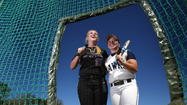 Lake Howell¿s Ashia Kerr, right, is shown with Winter Springs' Elizabeth Birle. Lake Howell opened its season with a 15-0 win over Seminole on Monday. (Gary W. Green/Orlando Sentinel)