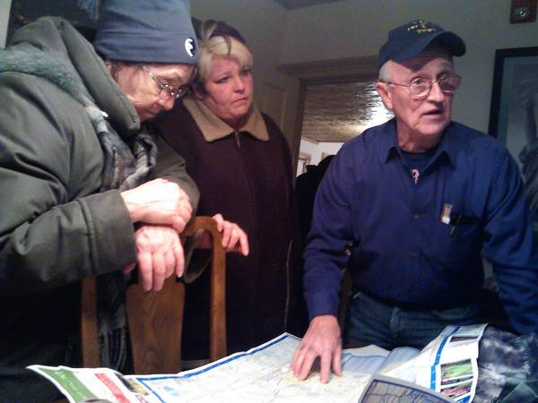 Bob Adams, president of the Midwest Shelter For Homeless Veterans, shows volunteers where to go during a homeless count on Jan. 30. Roughly 125 volunteers sweeped the streets of DuPage County, something they do every two years to count the number of people without homes.