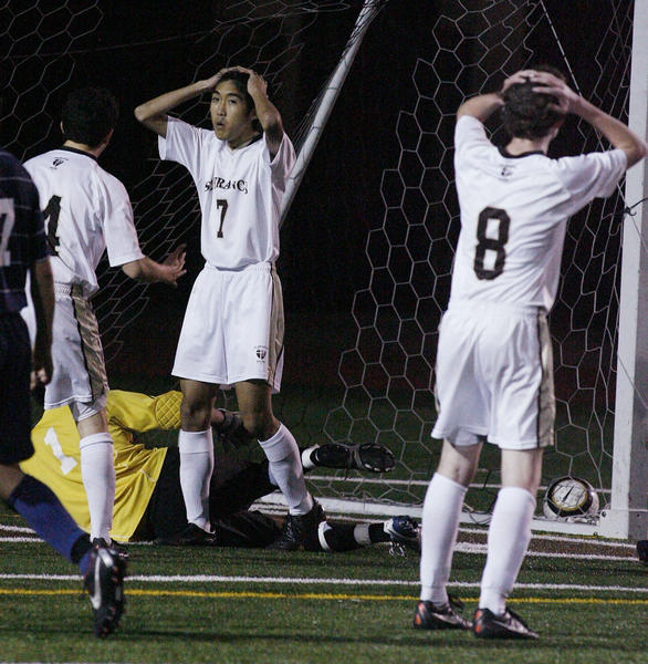 St. Francis' Reed Izumi, with his hands on his head in front of the Notre Dame goal after kicking the ball over the crossbar Dame in the second half in a Mission League soccer match at St. Francis High School in La Canada Flintridge on Monday, February 4, 2013. Notre Dame won the game 4-0.