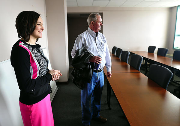Carol Rothstein, director of the Morgan County Center of the Blue Ridge Community and Technical College, and Peter Checkovich, president of Blue Ridge, scan a lecture room at the Berkeley Springs, W.Va., campus.