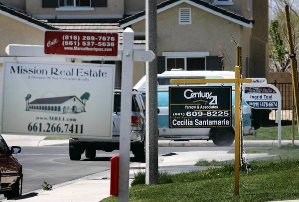 Homes on the market in the Antelope Valley in 2007 at the start of the subprime mortgage meltdown. The Justice Department is suing Standard & Poor's over its high ratings for mortgage securities that subsequently failed.