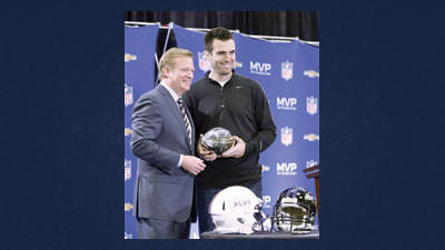 NFL Commissioner Roger Goodell poses for a photo with MVP Baltimore Ravens quarterback Joe Flacco at a news  conference Monday in New Orleans.