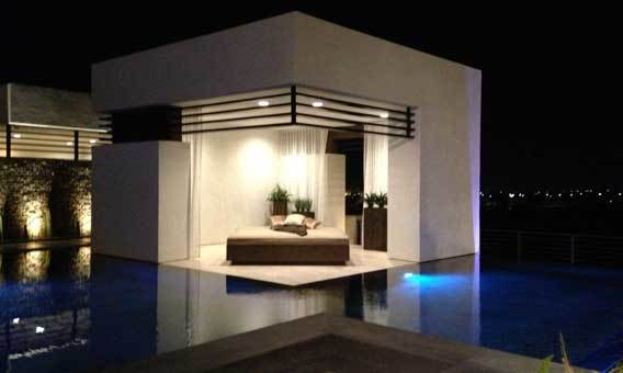 An outdoor room flush with the water level juts into the swimming pool.