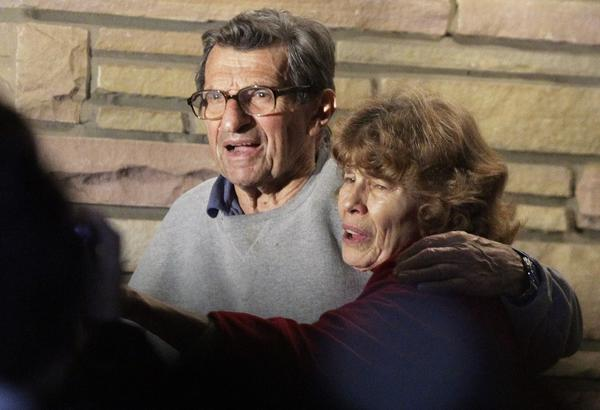 Joe and Sue Paterno stand on their porch.