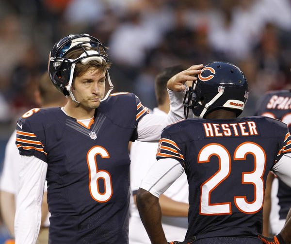 Bears quarterback Jay Cutler confers with receiver Devin Hester during their preseason game against the Washington Redskins last August.