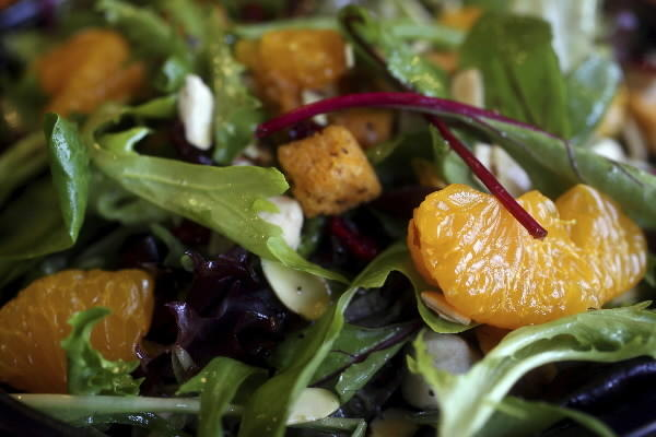 Make wise choices at the salad bar. Stick with fresh greens, vegetables and fruits, beans and low-fat salad dressings. Marinated vegetables, cheese, seasoned croutons and prepared salads will add extra calories and fat.