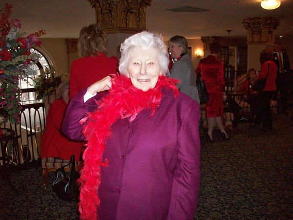 Priscilla Payne Hurd flaunts a red feather boa at the first Go Red for Women luncheon sponsored by the American Heart Association on Feb.18 a the Hotel Bethlehem. Hurd, the former chairman of the board of trustees of St. Luke