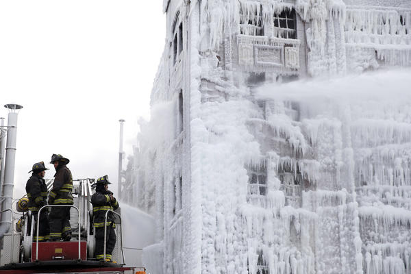 Chicago firefighters return to the scene of a warehouse fire on South Ashland Avenue in Chicago on Jan. 24. A fire that smoldered for hours into the previous day rekindled, almost a day and a half after prompting the largest fire department response in years.