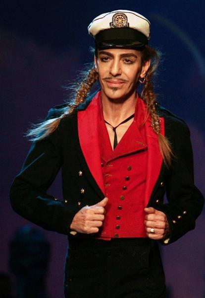 Fashion designer John Galliano strikes a pose.