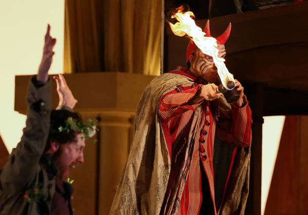 "Actor Wesley Daniel prepares to shoot a fireball during a dress rehearsal of Lyric Opera of Chicago's Wagner's ""Die Meistersinger von Nurnberg"" at the Civic Opera House Monday."