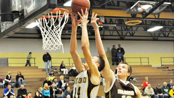 Gaylord's Brian Rabine grabs a rebound away from an Ogemaw player during Gaylord's loss to the Falcons on Friday.