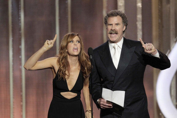 In this handout photo provided by NBCUniversal, Kristen Wiig and Will Ferrell on stage to present the Best Actress - Motion Picture, Comedy or Musical award during the 70th Annual Golden Globe Awards.
