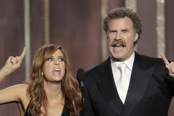 Kristen Wiig and Will Ferrell present an award during the 70th Annual Golden Globe Awards at the Beverly Hilton Hotel.