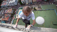 <b>Photos: </b>French daredevil climbs landmark Havana hotel without a net
