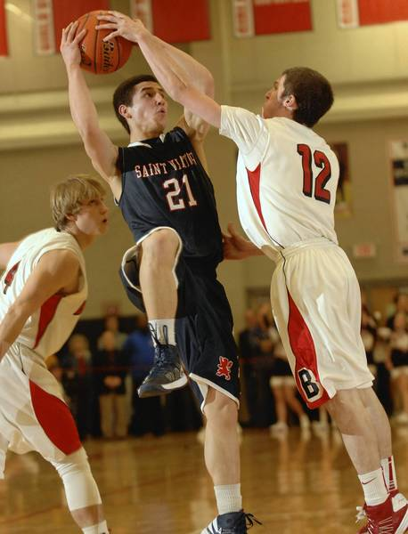 Mark Falotico of St. Viator is fouled by Colin Pelietieri of Benet Academy during a game on Feb. 1.