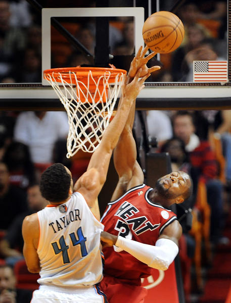 Miami's Dwyane Wade blocks the shot of Charlotte's Jeff Taylor.
