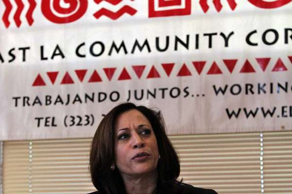 California Atty. Gen. Kamala D. Harris pictured in East Los Angeles talking to housing counselors.