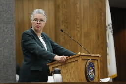Cook County Board President Toni Preckwinkle, seen here at last month's board meeting, won approval of an ordinance fining gun owners who don't report lost or stolen guns.