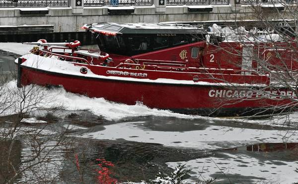 A fire boat breaks through ice on the Chicago River near  Columbus Drive, in downtown Chicago.