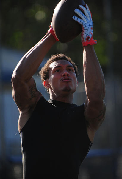 Brian Tyms of the Miami Dolphins works out at the Bommarito Performance Systems camp in Miami, Tuesday, Feb. 5, 2013, in Miami.