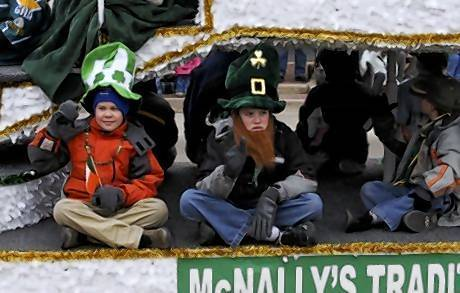 Spectators during a recent St. Patrick's Day parade in St. Charles. A planned festival to go along with the parade will be delayed until this summer.