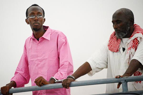 Somali journalist Abdiaziz Abdinur Ibrahim, left, in court in Mogadishu.